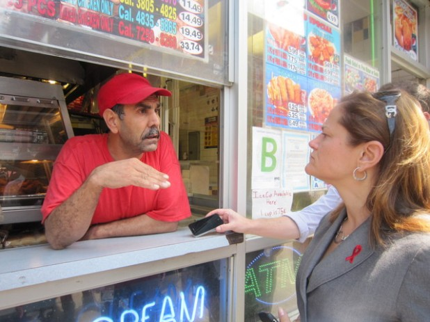Lal Barak, owner of Crown Fried Chicken at Lexington Avenue & East 116th Street, talks to Melissa about how Mayor Bloomberg's soda ban would hurt his business. (PHOTO CREDIT: DNAinfo/Jeff Mays)