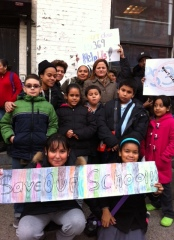 Melissa stands with PS 369X students.